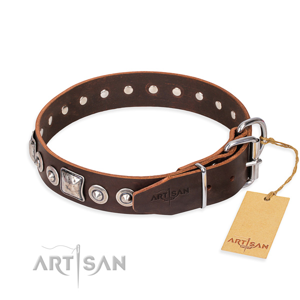Full grain leather dog collar made of gentle to touch material with reliable studs