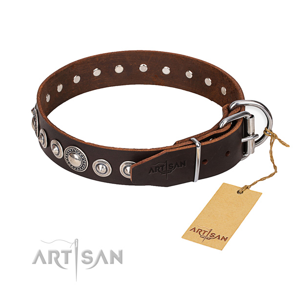 Natural genuine leather dog collar made of soft to touch material with corrosion proof hardware